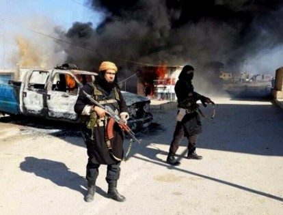 ISIS Fighters on the Iraq-Syria border. Iraq in Chaos; Afghanistan to follow?